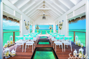 get married in a stunning over the water chapel at Sandals Resorts