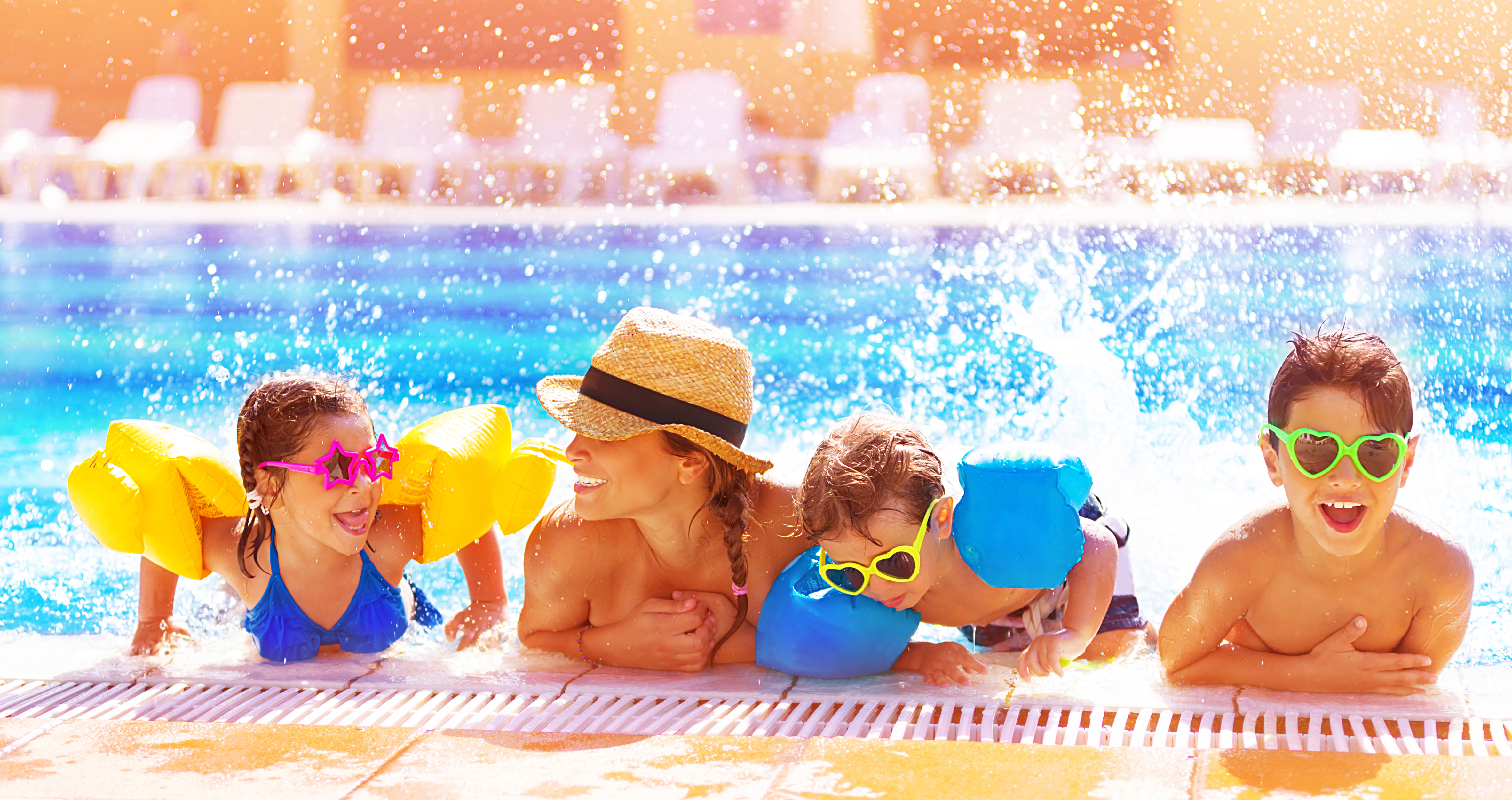 family holiday happy in a swimming pool